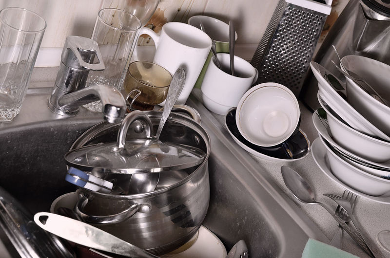 Close-up of utensils in sink at kitchen