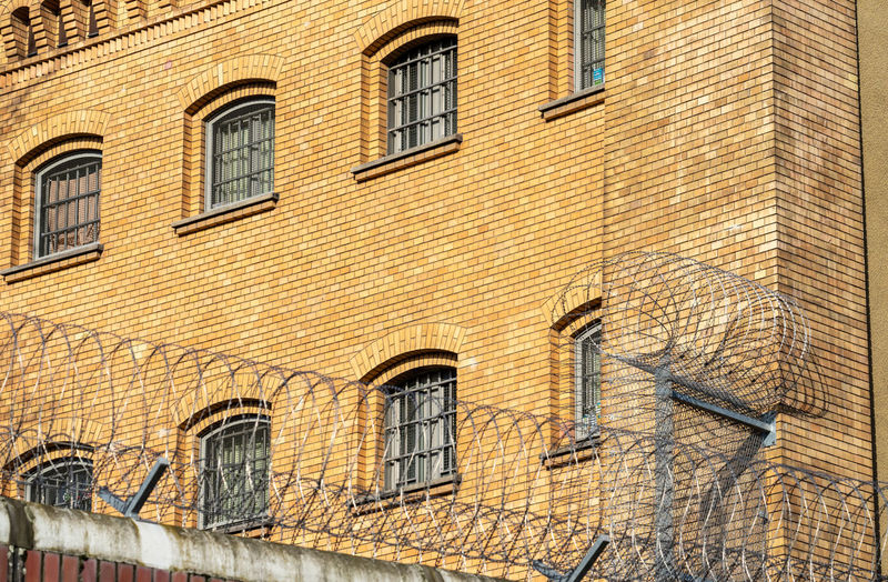 Barbed Wire Protection Security Secure Jailhouse Jail Prison Fence Wall - Building Feature Street Brick Brick Wall Low Angle View History Architecture Building Exterior Built Structure Wall City No People Building Arch The Past Outdoors