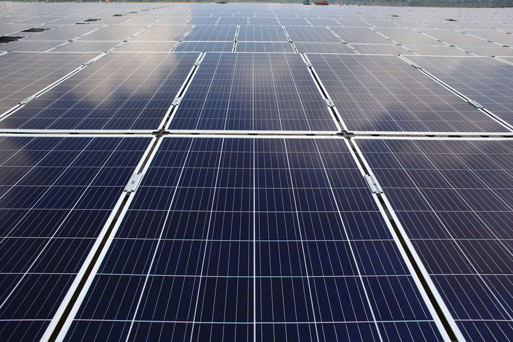 large scale solar farm Alternative Energy Economy Electricity  Environment Environmental Conservation Environmental Issues Fuel And Power Generation Nature Outdoors Pattern Power Supply Renewable Energy Roof Sky Solar Energy Solar Equipment Solar Panel Solar Power Station Sun Sunlight Sustainable Resources Technology