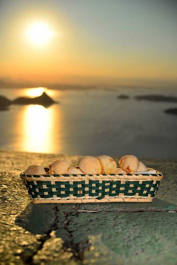 EyeEm Best Shots Eye4photography  Getting Inspired Cheese Puffs Cheese Bread Food And Drink Food Finger Food Pão De Queijo Sunset Sea Sky No People Selective Focus Nature Scenics - Nature Beauty In Nature Tranquility Sunlight Tranquil Scene Horizon Idyllic Beach Orange Color Horizon Over Water The Foodie - 2019 EyeEm Awards