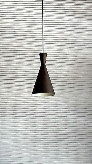 Close-up of electric lamp hanging on metal