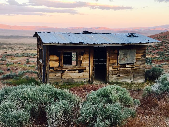 Mining ghost town Abandoned Built Structure Architecture Sky Building Exterior House Run-down Damaged Field No People Weathered Nature Outdoors Landscape Tranquility Bad Condition Scenics Day Grass Sunset The Great Outdoors - 2018 EyeEm Awards
