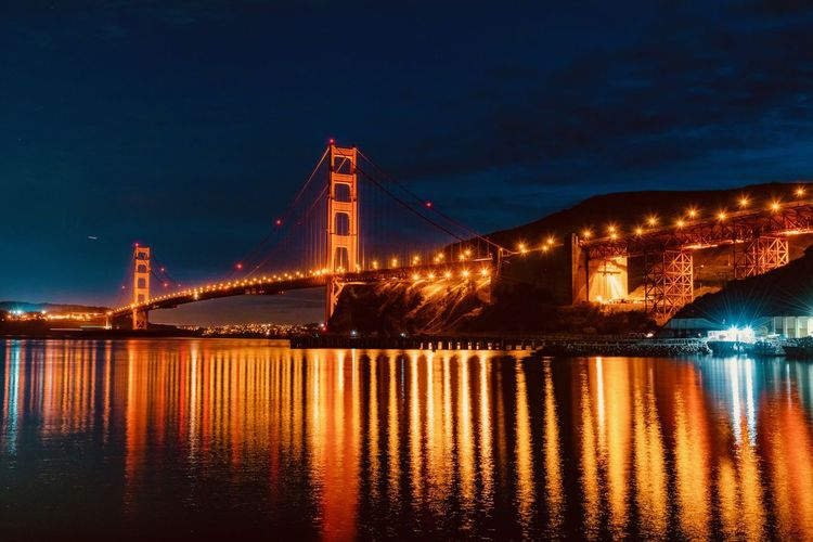 Water Illuminated Architecture Bridge Built Structure Bridge - Man Made Structure Transportation Night Connection Reflection Sky Waterfront Suspension Bridge Travel Destinations Nature Building Exterior Engineering City Outdoors Bay