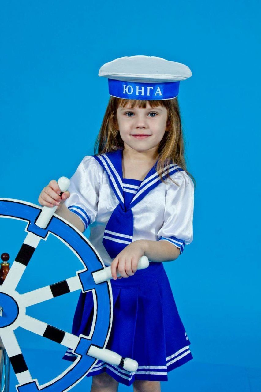 childhood, children only, looking at camera, blue, one person, sport, child, portrait, colored background, sports clothing, standing, confidence, uniform, uniform cap, sports uniform, blond hair, people, day