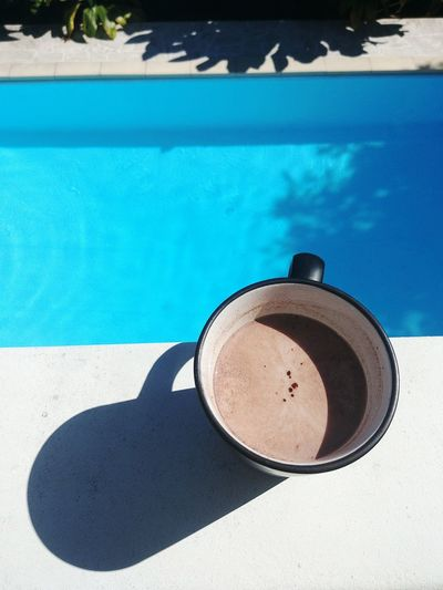 High angle view of drink in swimming pool