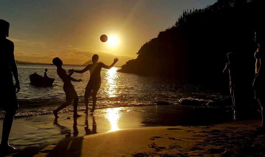 Sunset Beach Water Boys Playing Ball Sport People Vacations Nature Spirituality Beauty In Nature Mode Of Transport Tranquil Scene Reflection Tourism Travel History Transportation Scenics Travel Destinations Building Exterior Tranquility People Photography Nature