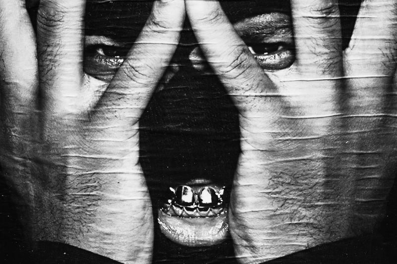 What can I do for you ? Cagoule Dark Angel Black And White Photography Golden Teeth Jokerface Man Hiden Behind His Hands Mocking Bird Portrait