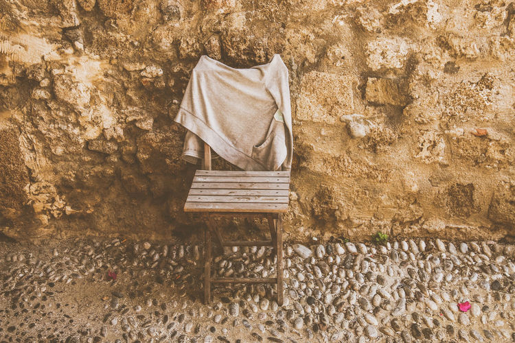 Seat Wall - Building Feature Absence Wall No People Bench Wood - Material Chair Stone Wall Day Old Empty Architecture Built Structure Outdoors Building Exterior Relaxation Nature Damaged Weathered Rhodos, Greece  Snapshot Eyeem Travel