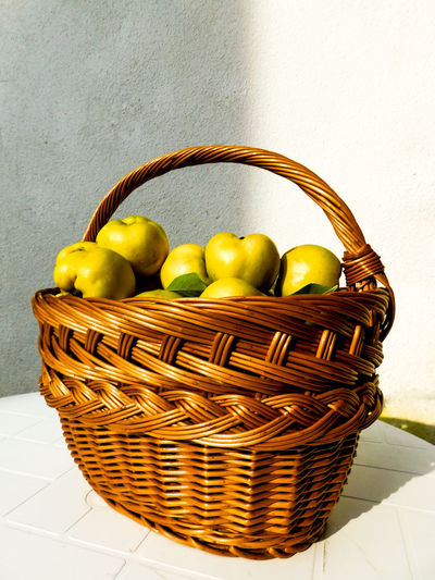 Quinces in a basket Bro EyeEm Nature Lover EyeEmNewHere Freshness Basket Basket Of Fruit Day Food Food And Drink Freshness Fruit Healthy Eating Healthy Lifestyle Home Grown Food Nature Gifts No People Picnic Basket Produce Quince Whicker Yellow