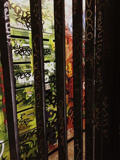 Close-up of graffiti on glass wall