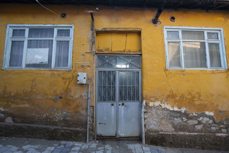 Architecture Built Structure Building Exterior Window Building Yellow House Closed Residential District No People Door Entrance Day Security Outdoors Glass - Material Protection Old Safety Wall Window Frame
