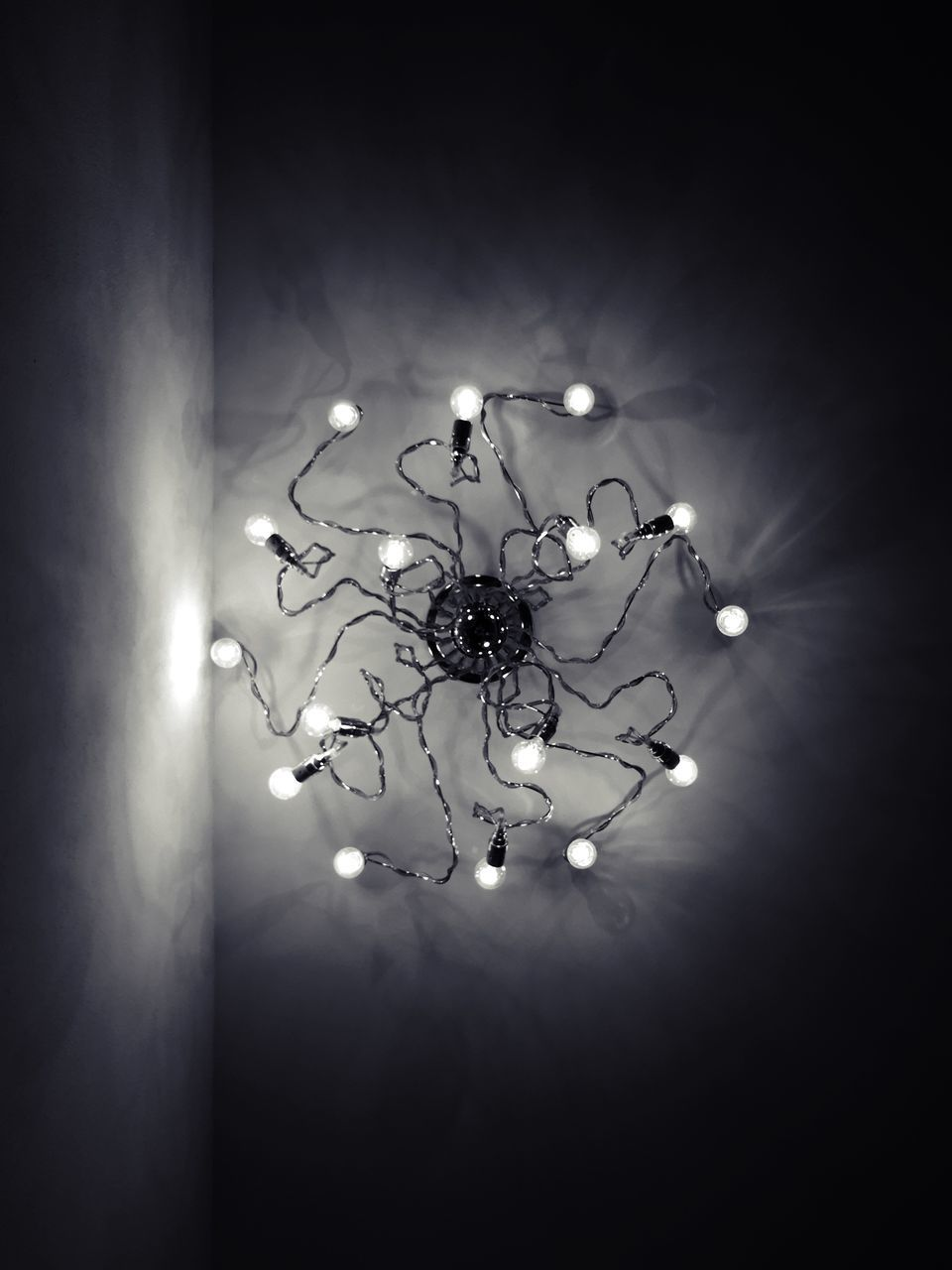 Directly Below Shot Of Hanging Light At Ceiling