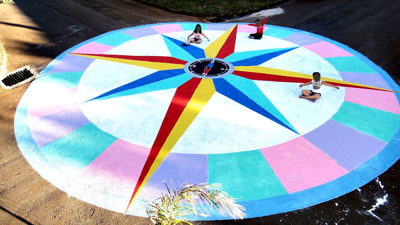 multi colored, circle, day, geometric shape, close-up, pattern, outdoors, high angle view, shape, no people, umbrella, nature, leisure activity, protection, sunlight, blue, security, sport