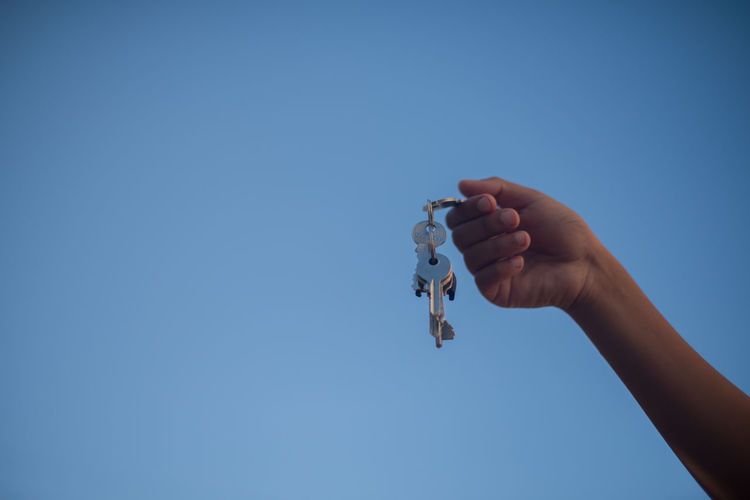 Close-Up Of Hand Holding Keys