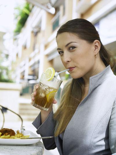 Portrait Of Businesswoman Having Drink