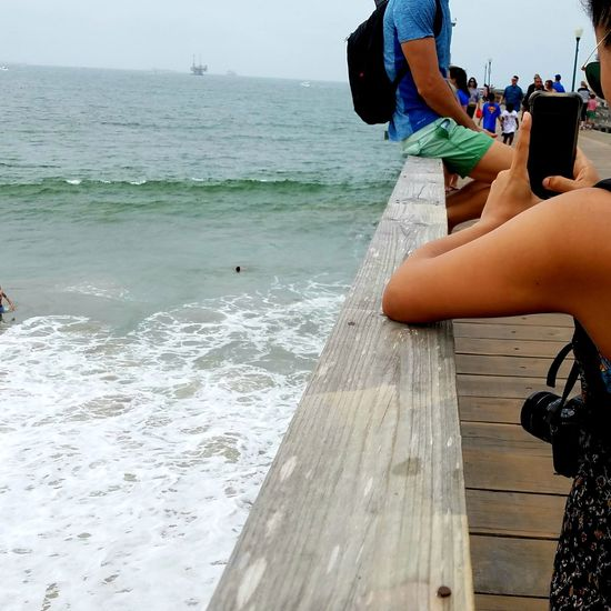 Photography At The Beach  DSLR Cellphone Photography Smartphone POSED Sitting On Railing Sitting Rail Pier Photographer Vacations Water Lifestyles Relaxation Leisure Activity Copy Space Background Meditation Togetherness Real People Friends Enjoying The Moment Wood Streetphotography Breathing Space