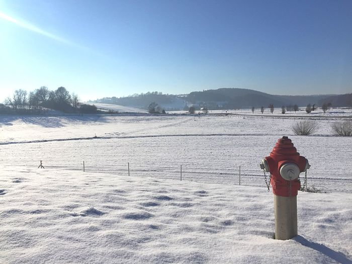 Fire Hydrant On Snowcapped Field During Winter