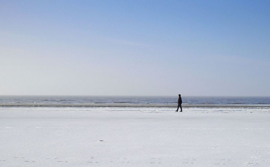 beautiful wide and snowy beach in sankt peter ording Lost In The Landscape Beautifully Organized Beautiful Nature M Breathing Space Perspectives On Nature Enjoy The New Normal Landscape Landscape_Collection Feel The Journey Landscapes With WhiteWall The Great Outdoors - 2017 EyeEm Awards Finding New Frontiers Minimal People Of The Oceans Minimalobsession Photography In Motion Sea Serenity Shore Tranquil Scene Tranquility Walking Water Original Experiences Blue Wave Fashion Stories Shades Of Winter An Eye For Travel