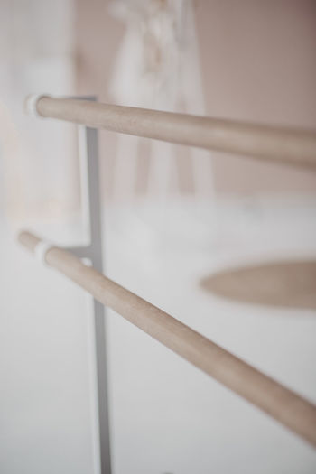 Close-up of railing on table in building