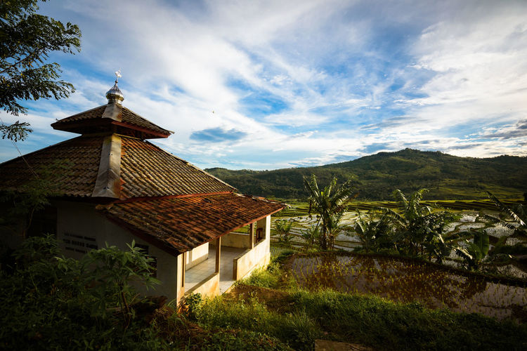 Abandoned mosque on coutryside Abandoned Architecture Beauty In Nature Building Building Exterior Built Structure Cloud - Sky Day Environment House Land Landscape Mosque Mountain Nature No People Outdoors Paddy Field Plant Roof Scenics - Nature Sky Tree Village