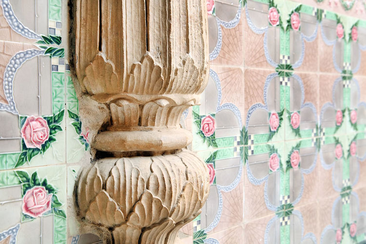 Close-Up Of Old Column On Tiled Wall