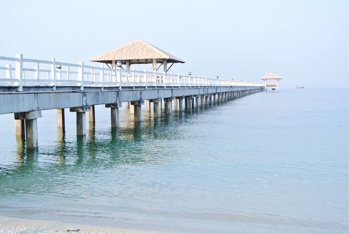 Pier Sea Water Pier Built Structure Tranquility Stilt Outdoors Nature Horizon Over Water Beach Scenics No People Clear Sky Sky Beauty In Nature Stilt House Jetty Day Architecture Tranquil Scene