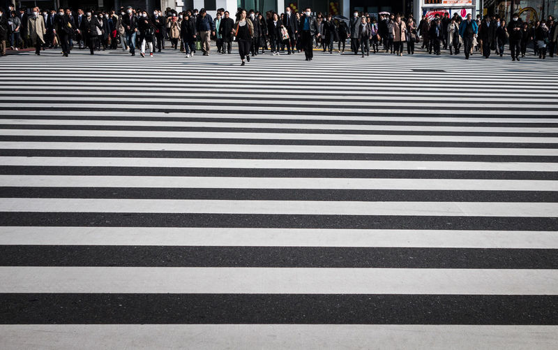 Crowds walking on zebra crossing