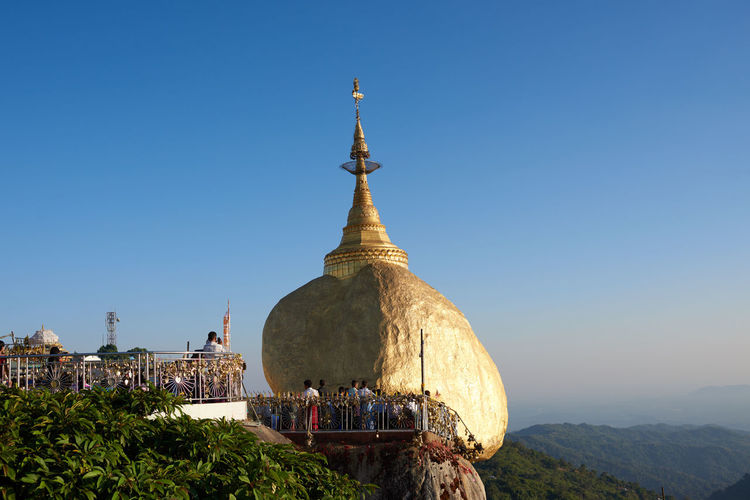 Goldenrock, Myanmar #goldenrock #Myanmar Architecture Building Exterior Built Structure Clear Sky Day Mountain Nature No People Outdoors Place Of Worship Religion Sky Spirituality Travel Destinations