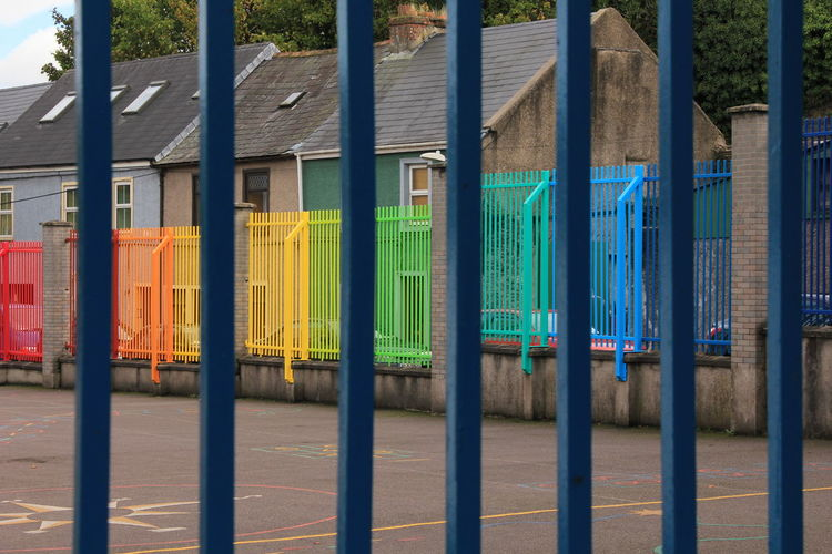 City School, Multi Colour Gates, Behind Bars, Multi Colored Metal Green Color Yellow No People Day Outdoors Parallel Close-up
