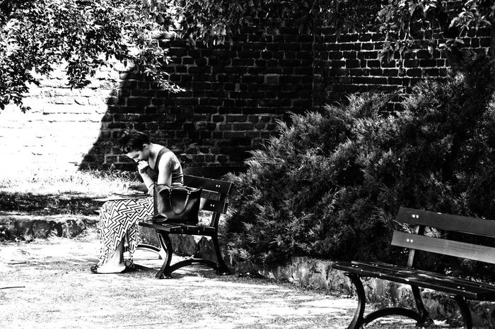A Girl on a bench in a park in Gdansk. A Moment In Time Blackandwhite Deep In Thought In The Park Real People