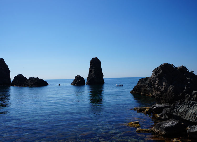 Catania, Sicily Cyclops' Coast Riviera Dei Ciclopi Sicily's Riviera Dei Ciclopi Beauty In Nature Blue Clear Sky Day Horizon Over Water Idyllic Nature No People Outdoors Riviera Dei Ciclopi Rock - Object Rock Formation Scenics Sea Sky Tranquil Scene Tranquility Water Waterfront
