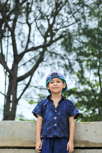 Portrait of boy wearing cap standing outdoors