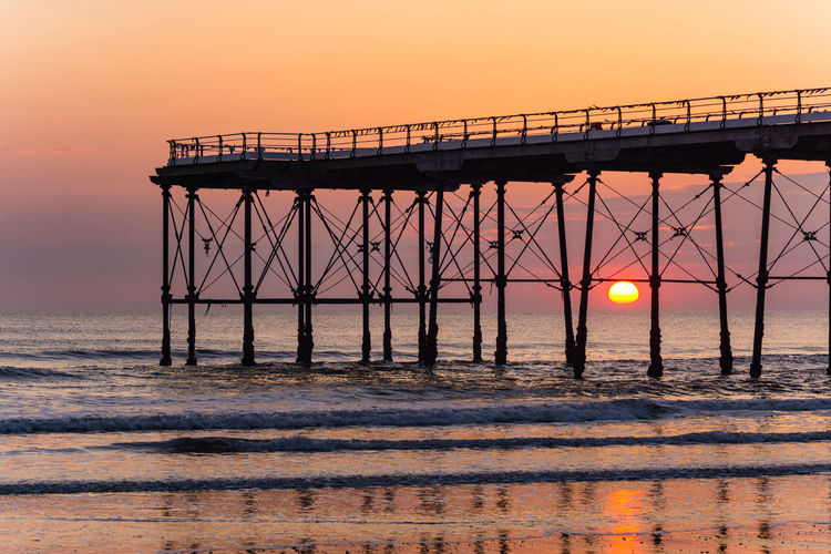 Saltburn pier at sunrise. Saltburn is a small seaside town on the north east coast of England. It was about 5am and there was no one else here. Had it all to myself. Saltburn Saltburn By The Sea Saltburn Pier Teesside Yorkshire North Yorkshire England Europe European  North East UK North East England North East Coast Pier Piers Pier Sunrise Sky Sunset Water Nature Sunset_collection Sunset Silhouettes Sunset #sun #clouds #skylovers #sky #nature #beautifulinnature #naturalbeauty #photography #landscape Sunsets Piers Sunset Sea Ocean Seascape Sunrise Sunrise_sunsets_aroundworld Sunrise_Collection Sunrise Silhouette Sunrise And Clouds Piers Sunrise Structure Landmark Uk Pier England Pier Beauty In Nature Beach Beachphotography Beach Photography Beach Life Summer Seasons Summer Sun Summer Sunrise
