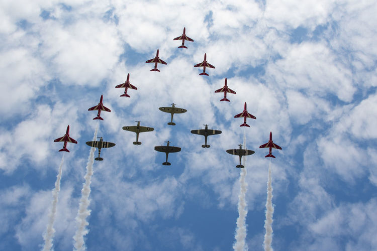 New and Old in formation Formation Air Force Airplane Airshow Arrangement Close-up Cloud - Sky Clouds Display Flying Formation Flying Group Military Military Airplane Passing Passing By Red Arrows Spitfire Spitfires Team Teamwork Tight Togetherness Trail Ww2