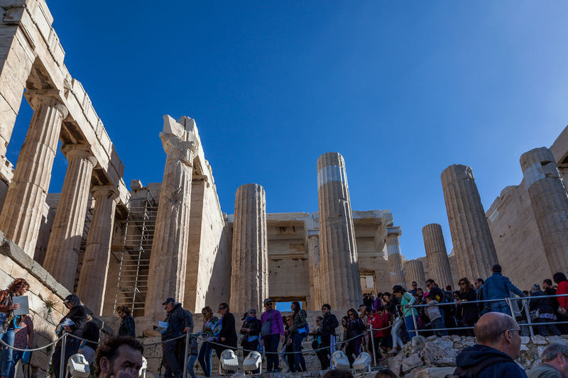 Athens greece - crowd of tourists near the entrance of acropolis propylaea