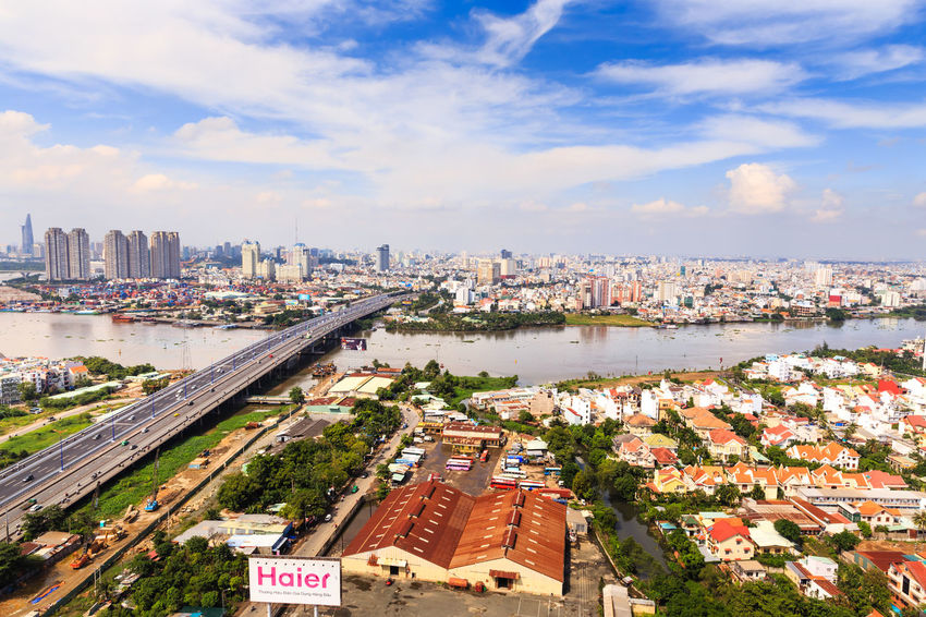 Hochiminh City, Vietnam - October 21, 2013: A view of panoramic Saigon Bridge on the SaiGonriver. This is a very important bridge, from the HoChiMinh city leads to the north provinces of Vietnam. It spans the Saigon River where container cargo ships crossing continuously Aerial View Architecture ASIA Built Structure Business Canal Cargo Ship City Life Container Ship Destination Development Harbor Hochiminh City Important Morning Outdoors Retail  River SaiGon Bridge Scene Skyline Tower Travel Vacation Water