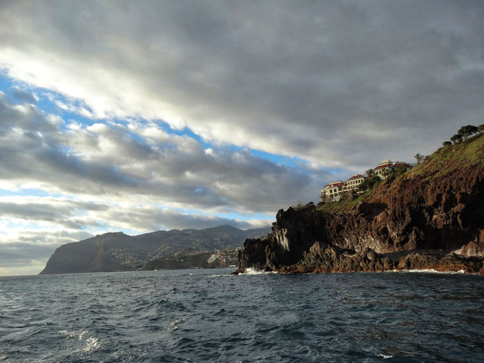 Scenic shot of coast. Sky Cloud - Sky Water Sea Scenics - Nature Beauty In Nature Waterfront Mountain Nature Tranquil Scene No People Tranquility Land Outdoors Day Beach Overcast Storm Ominous Coast Coastline Coastal Feature Madeira Madeira Island Island