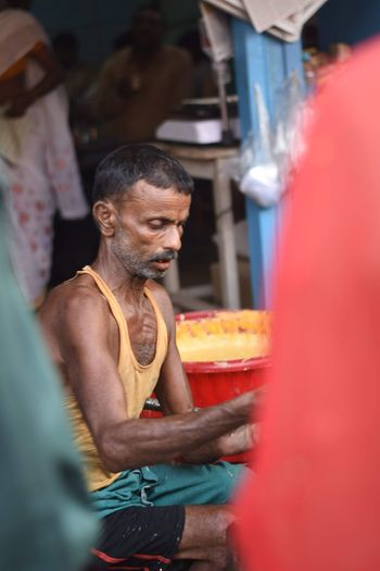Man holding food at market stall