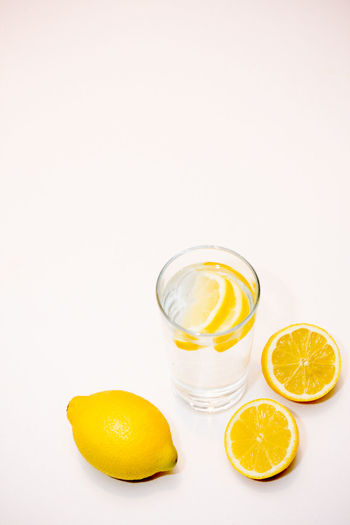 Arrangement Close-up Composition Drink Food And Drink Glass Healthy Eating Healthy Lifestyle Lemon Lemon Water Lemons Negative Space No People Preparation  Refreshment Simplicity Sliced Still Life Water White Background Yellow Things I Like My Favourite Breakfast Moment