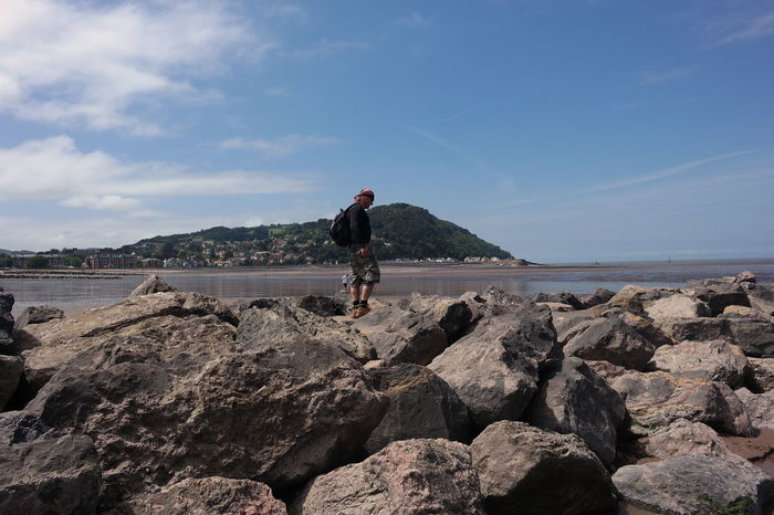 Walking along the beach at Minehead Hillside Man Rocks And Water Sea And Sky Seascape Seaside Sommergefühle