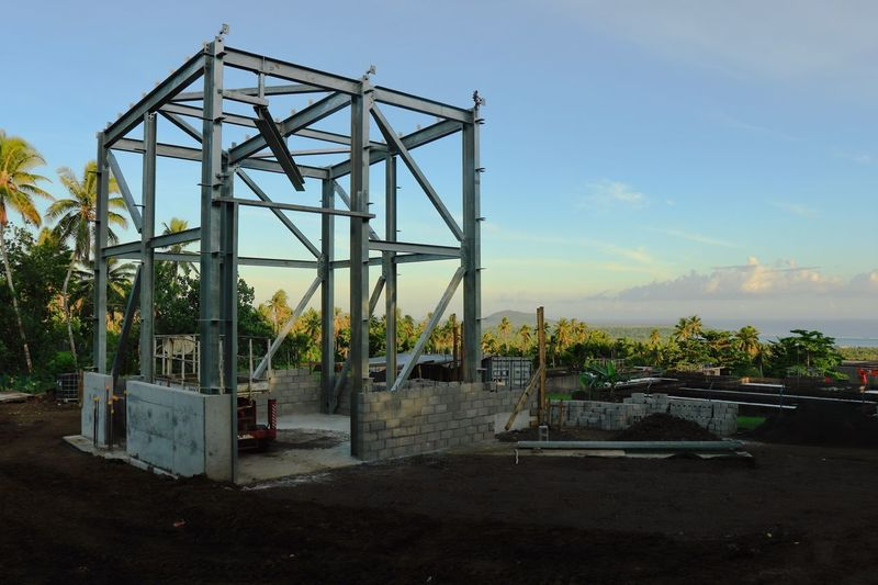 A work in progress, Savai'i's first renewable energy source, the bones of the powerhouse. Progress Green Clean The First One Savai'i, Samoa Samoa  Renewable Energy Hydroelectric Power Sky Built Structure Nature Plant No People Tree Construction Industry Construction Site Blue Land Sunlight Day Metal