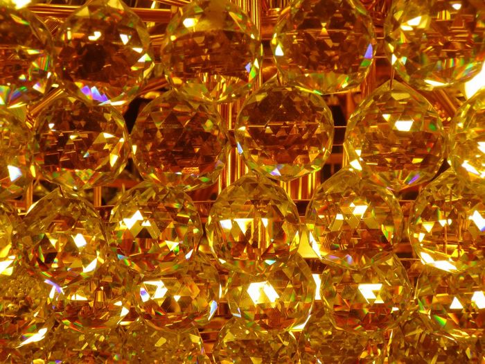 Sparkling Chandelier Decoration Lighting Equipment Full Frame Illuminated Christmas Crystal Shiny Close-up Indoors  Yellow Color Brass Gold Colored