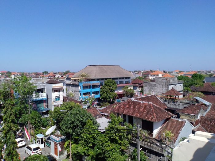 Building with blue sky Architecture Built Structure Building Exterior Building Roof Sky City Residential District House Clear Sky High Angle View Nature Plant Copy Space Day No People Tree Blue Town Outdoors Roof Tile TOWNSCAPE