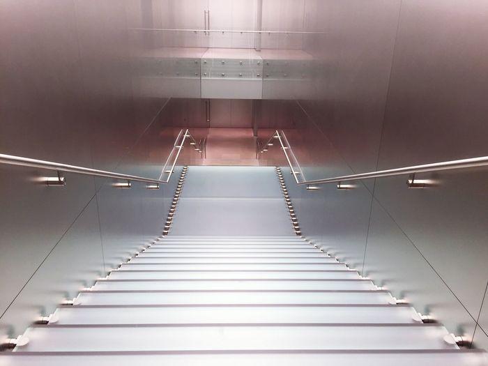 High angle view of narrow stairs along walls