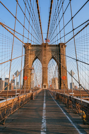 The famous Brooklyn Bridge in New York city crossing the East River Blue Sky Bridge Bridges And Waterways Brooklyn Bridge / New York Cable Bridge Cables East River Famous Historic Lance Mark Land Mark New York City New York Harbor Pedestrian Walkway