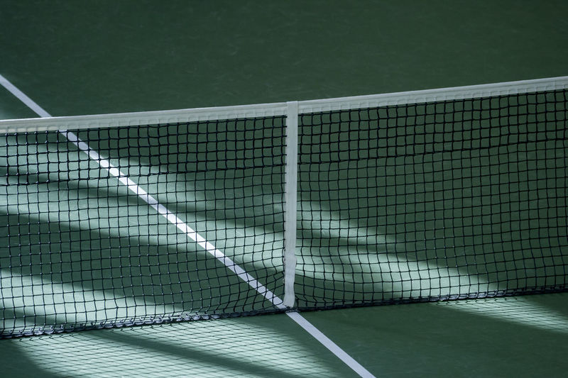 Net of tennis court Court Tennis Tennis 🎾 Design Sport Net Active Club Net - Sports Equipment Tennis Net No People Absence Day Nature High Angle View Outdoors Sunlight Sports Equipment Green Color Tennis Ball Close-up Pattern Shadow Metal Focus On Foreground Swimming Pool