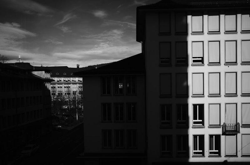 Buildings against sky at dusk