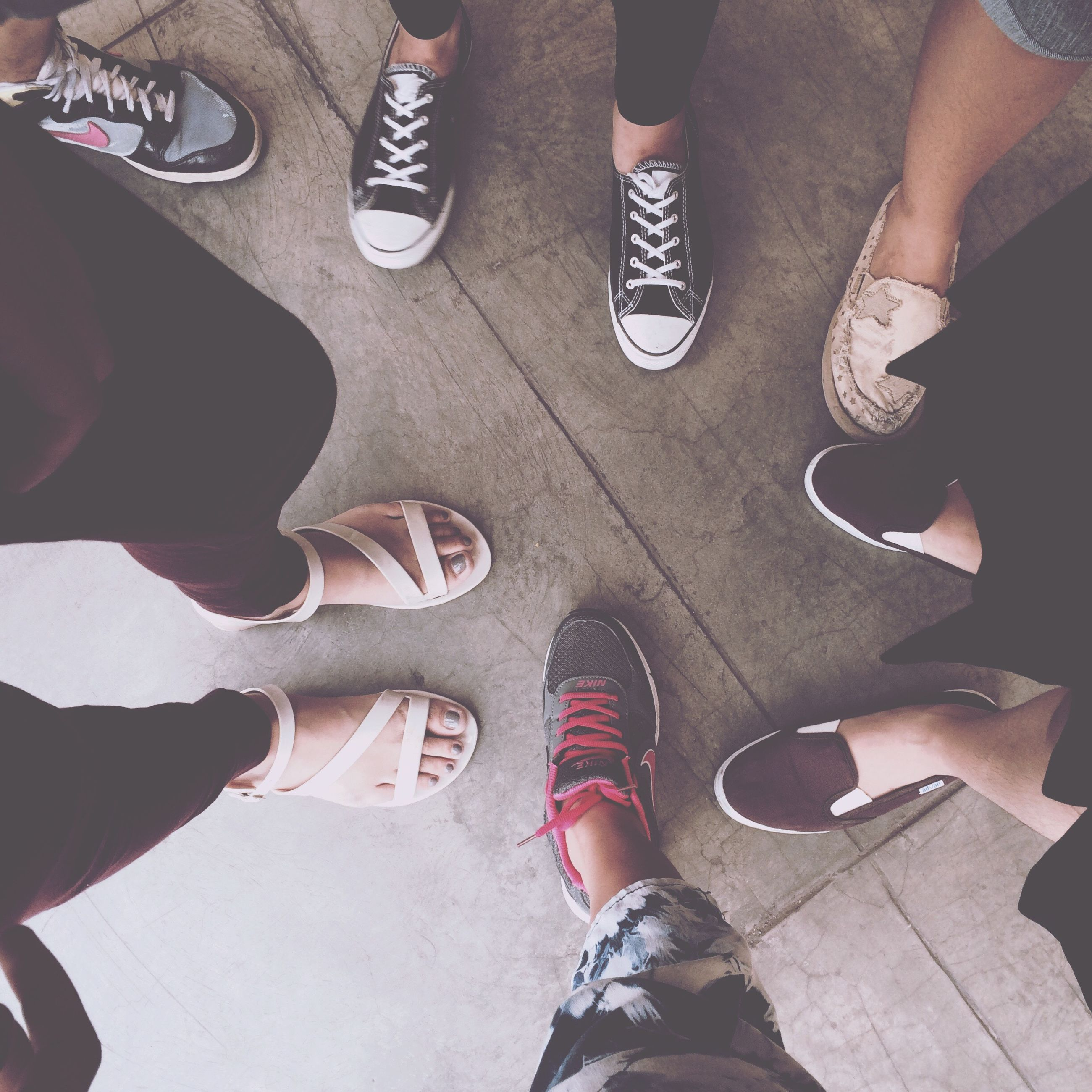 low section, person, shoe, lifestyles, human foot, standing, personal perspective, men, leisure activity, togetherness, part of, friendship, high angle view, footwear, jeans