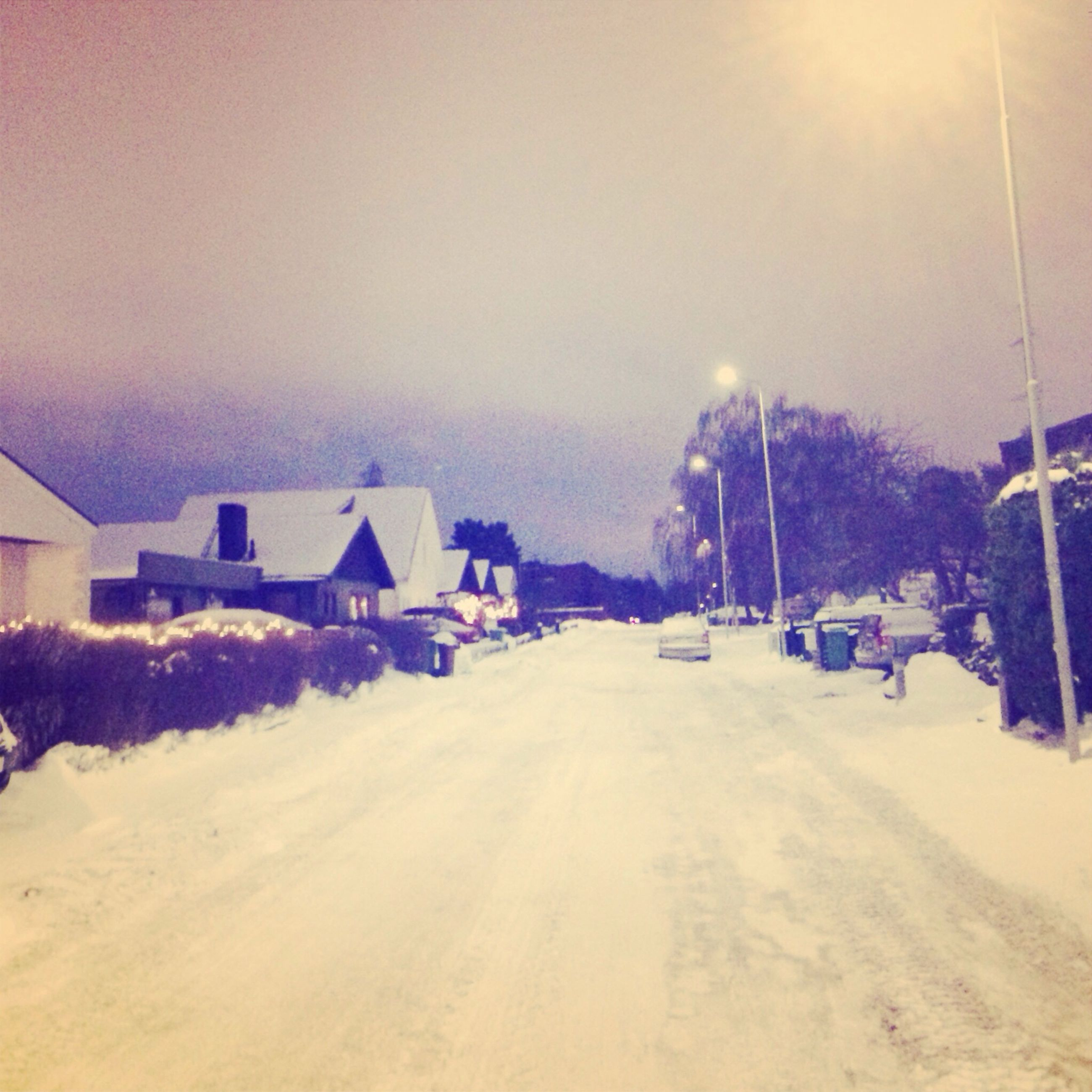 snow, winter, cold temperature, building exterior, architecture, built structure, weather, season, house, transportation, the way forward, road, sky, street, residential structure, car, land vehicle, covering, landscape, incidental people