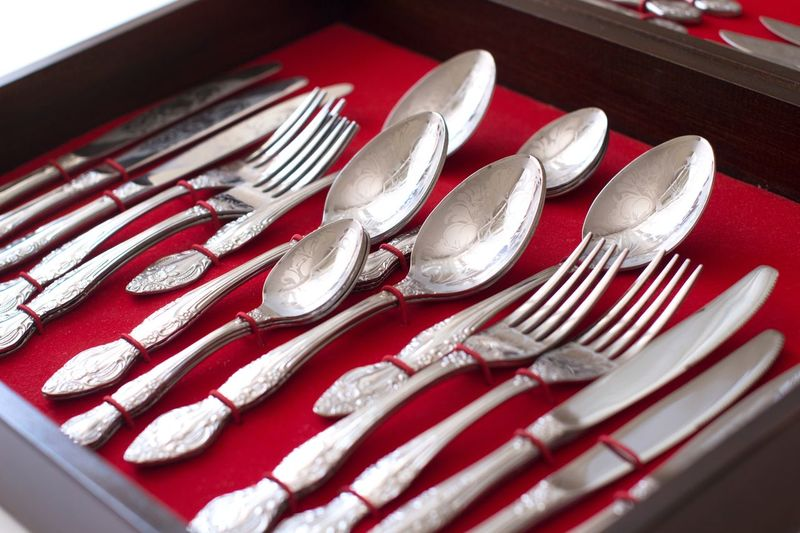 High angle view of cutlery in box